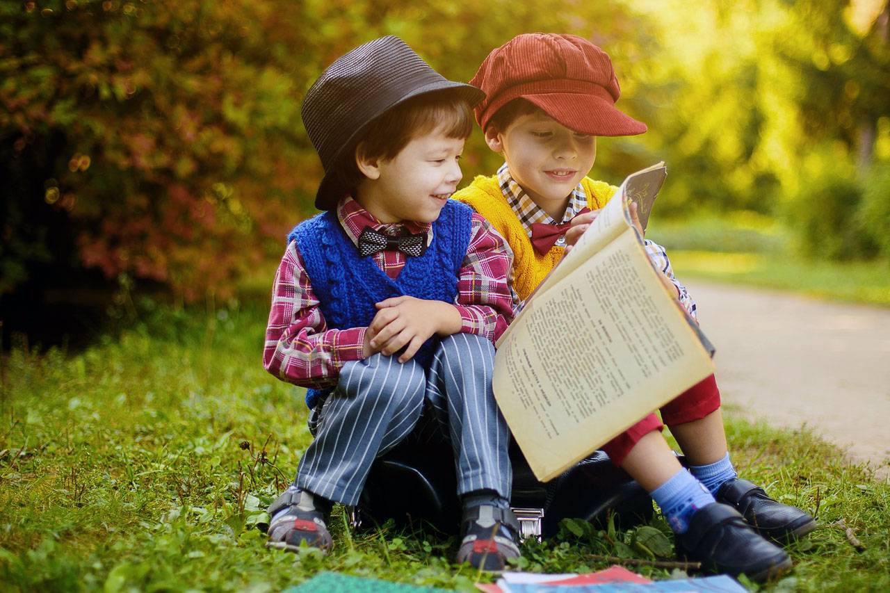 Children Reading Newspaper Outside 1280×853