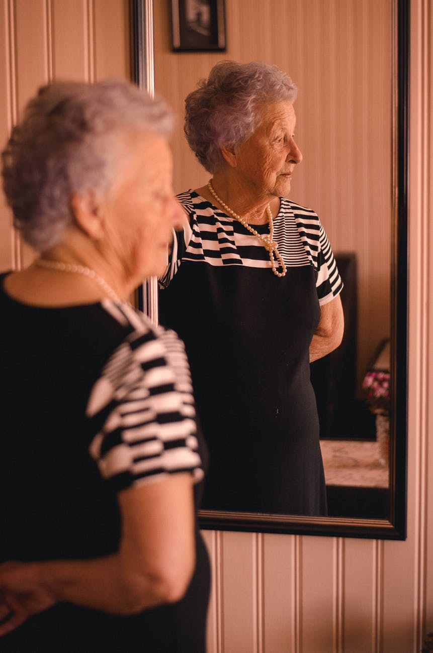 optometrist, age related macular degeneration woman looking at mirror